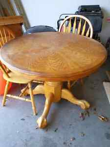 Solid Oak pedestal table with leaf  and 4 chairs