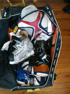 Youth hockey equipment and rolling bag