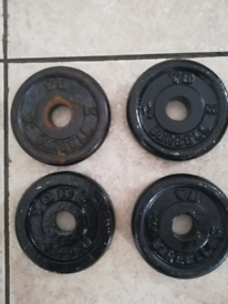 4 x 1.25kg weight plates. For 1 inch standard bar. Good condition