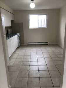 Available now: Bright, 2 bdrm apt with parking/intercom/laundry