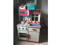 Kids wooden toy kitchen with food and till