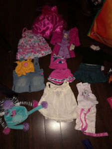 Doll clothes that fit American girl dolls.
