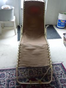 chaise longue pliante usagé