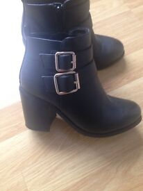 Black heeled boots with gold buckles size 3