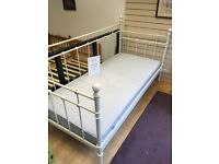 White metal bed with mattress