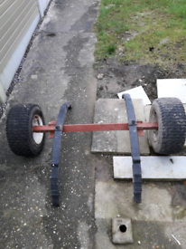 Trailer axel with springs