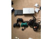 PlayStation 2.two consoles 30 games