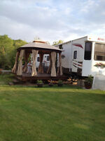 Beautiful destination trailer on large lot in Katepwa RV Park