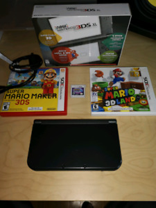New Nintendo 3DS XL mint condition with 3 games and original box