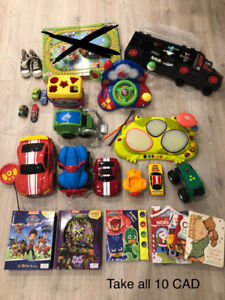 Toddler toys + diapers  (take all 10CAD)