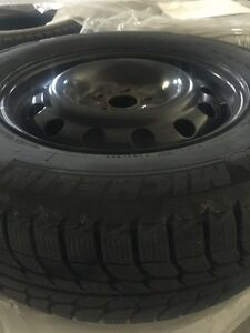 Michelin 215/70 R 16 studless winter tires on rims