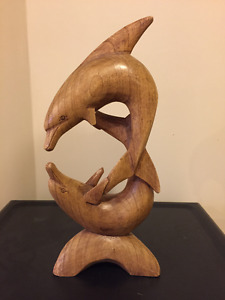 Hand carved wood dolphin sculpture