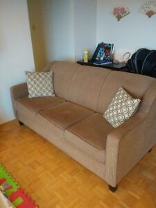 A Couch and a speaker for sale