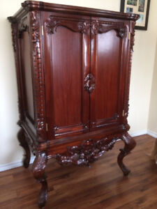 Hand carved solid wood armoire