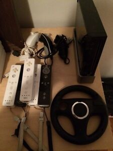 Console WII, manettes, nunchucks, balance board, 10 jeux