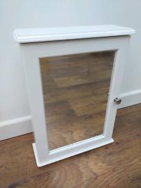 Mirrored white bathroom cabinet.