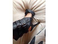 Black studded buckle stilettos