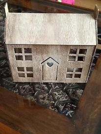 Little house with flickering pretending candle