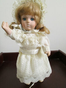 Vintage Porcelain or Ceramic Doll with Movable Parts.