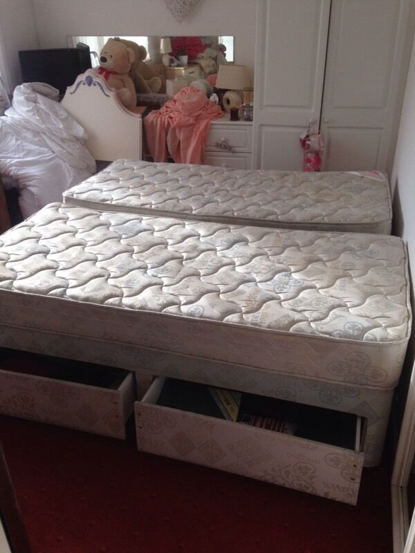 Two single beds and mattresses