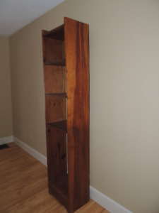 Solid narrow bookcase.