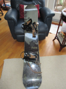 Canadian Option Redline Snowboard with Drake Bindings.