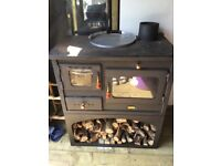 Log burning stove with oven
