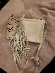 Nude off-white purse with a snakeskin and fringe detail