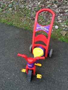 "Fisher Price  ""Rock Roll and Ride"" Tricycle"
