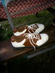 Leather traditional golf shoes.