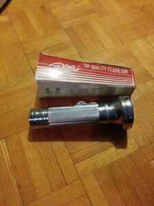 Old flashlight never use . Trade for silver