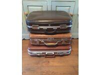 Three vintage/retro suitcases