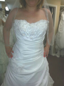 2 wedding dresses  size 14 and 20