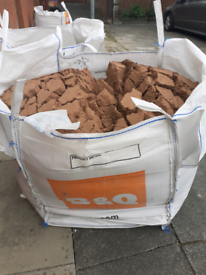 Bag and half of building sand