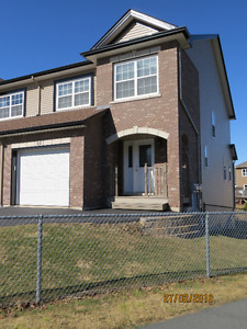 End-unit executive townhouse located in Russell Lake West