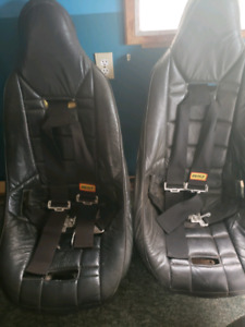 racing seats with 4 point harnesses.