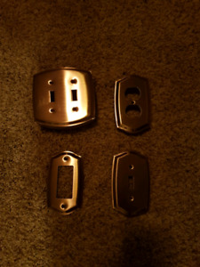 Brushed nickel wall plates