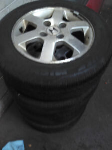 1990 TO 2002 ACCORD 4 BOLT RIMS AND TIRES