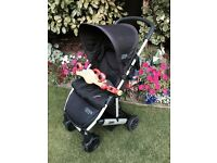Mamas and Papas Ora with cosy toes, ELC Pram toy and changing bag.