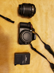 Nikon D5100 DSLR camera with accessories and bag