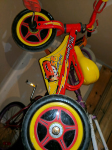 3 ride on toys + lightening McQueen tricycle