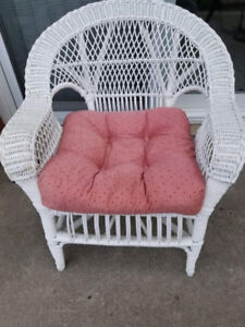 White wicker chair including seat pillow