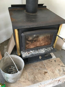 Nice solid wood stove for sale, pick up only, 200 OBO