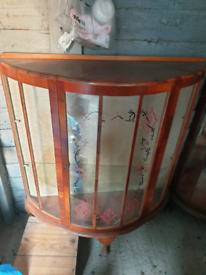 Walnut antique bow front display cabinet