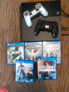 PlayStation 4 with 2 wireless controllers