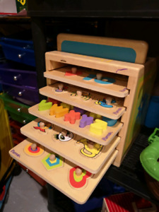 5 wooden puzzles in wooden storage box