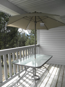 Patio dining table with umbrella