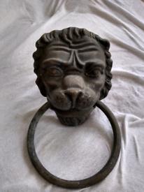 Unusual lion door knocker