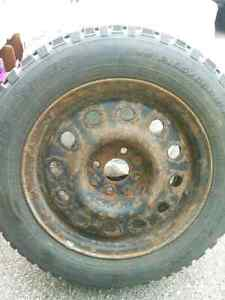 1st Snowfall Deal -Used Studded Tires On Rims (4 bolt) 185/65/15 West Island Greater Montréal image 1