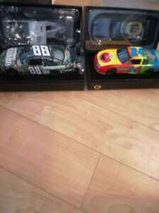 Large collection of 1/24 scale die cast NASCAR ELITE cars.